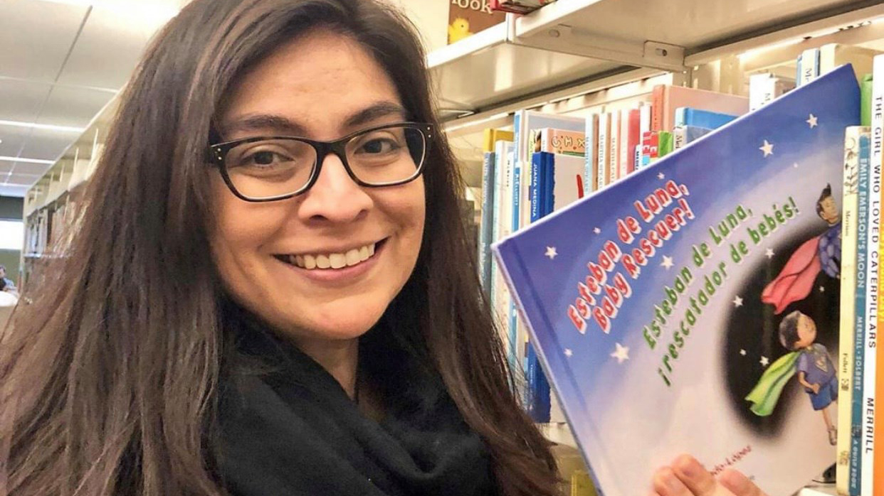 Mercado-Lopez with her children's book